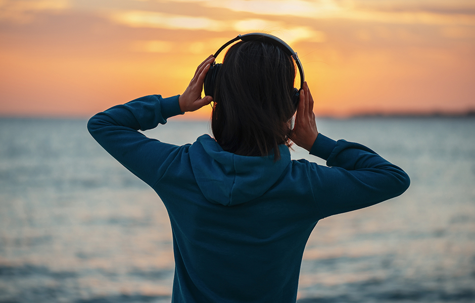 Woman listening to self care audiobooks