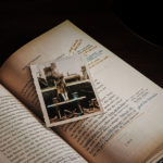 Vintage photograph sitting inside a book with notes in the margins
