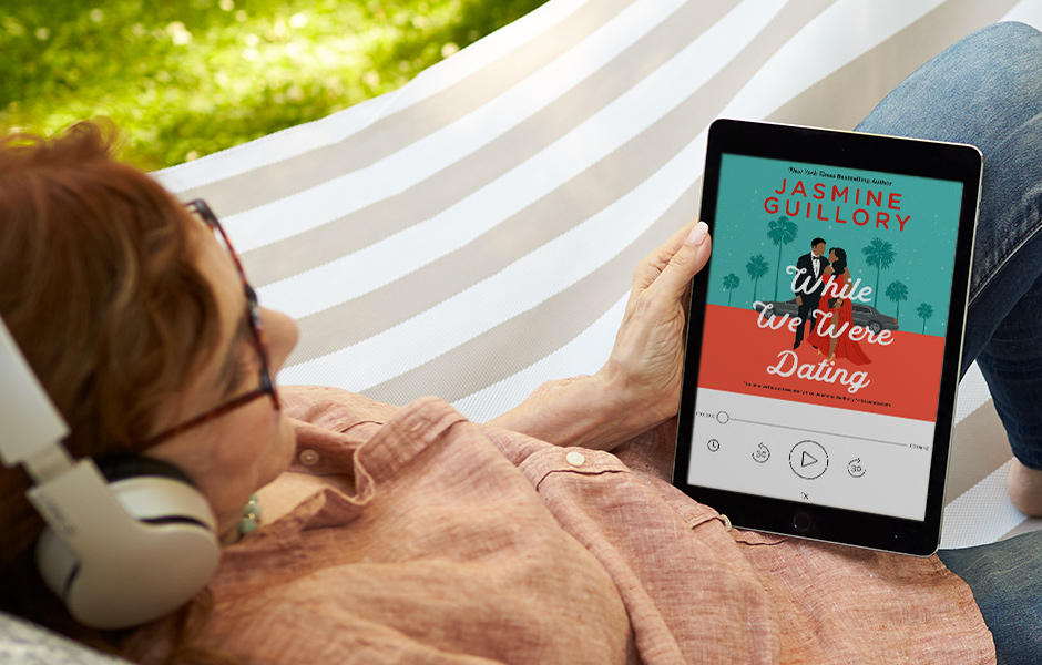 Woman in a hammock listening to WHILE WE WERE DATING on an ipad