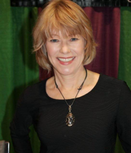 Headshot of Friday the 13th Star and The Final Girl Support Group narrator Adrienne King