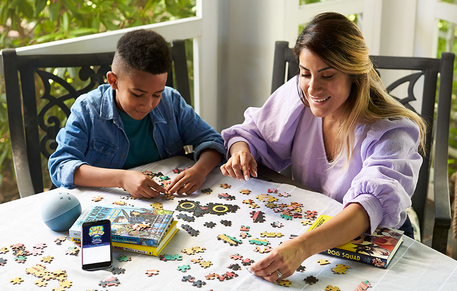 Image of Child and Adult doing a puzzle together for Back to School Stress Management for Parents and Children post